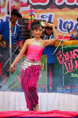 PAYAKKAPHUMPHISAI, MAHASARAKHAM - MAY 19 : Unidentified dancer is performing in traditional north-east Thai sky rocket ceremony and festival on May 19, 2012 at footbal playground, Payakkaphumphisai, Mahasarakham, Thailand.