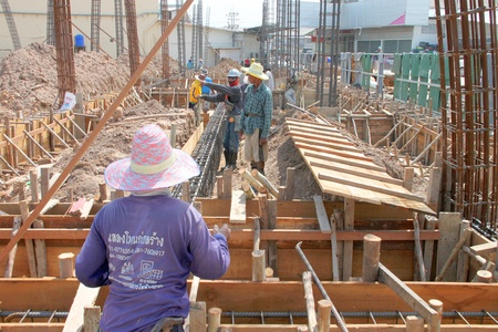 MUANG, BURIRAM - JUNE 9 : Unidentified men are working in the building site on June 9, 2012 at Taweekit Plaza, Muang, Buriram, Thailand.