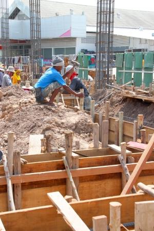 MUANG, BURIRAM - JUNE 9 : Unidentified men are working in the building site on June 9, 2012 at Taweekit Plaza, Muang, Buriram, Thailand.