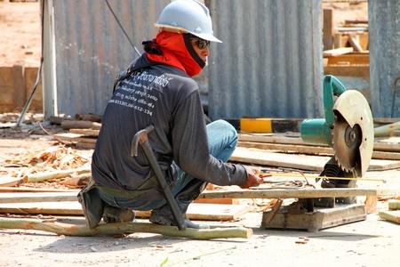 coolie hat: MUANG, BURIRAM - JUNE 9 : Unidentified man is working in the building site on June 9, 2012 at Taweekit Plaza, Muang, Buriram, Thailand.
