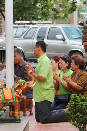 MUANG, MAHASARAKHAM - JUNE 16 : Unidentified tourists are in worship the shrine of city pillar on June 16, 2012 at The shrine of city pillar, Muang, Mahasarakham, Thailand.