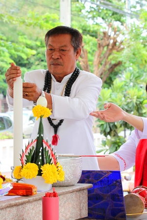 MUANG, MAHASARAKHAM - JUNE 16 : Unidentified Brahman is in worship the shrine of city pillar on June 16, 2012 at The shrine of city pillar, Muang, Mahasarakham, Thailand.