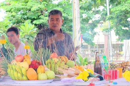 MUANG, MAHASARAKHAM - JUNE 16 : Unidentified man is in worship the shrine of city pillar on June 16, 2012 at The shrine of city pillar, Muang, Mahasarakham, Thailand.
