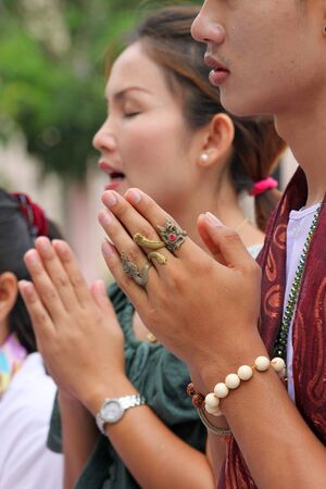 MUANG, MAHASARAKHAM - JUNE 16 : Unidentified woman is in worship the shrine of city pillar on June 16, 2012 at The shrine of city pillar, Muang, Mahasarakham, Thailand.