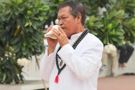 glorify: MUANG, MAHASARAKHAM - JUNE 16 : Unidentified Brahman is in worship the shrine of city pillar on June 16, 2012 at The shrine of city pillar, Muang, Mahasarakham, Thailand. Editorial