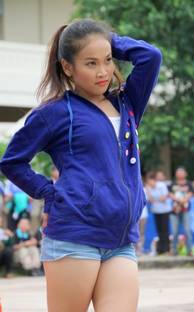 MUANG, MAHASARAKHAM - JUNE 24 : Unidentified dancer is performing in mini - half marathon contest and festival on June 24, 2012 at city plaza, Mahasarakham, Thailand. Stock Photo - 14148995
