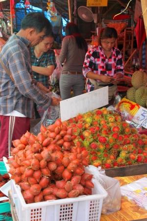 CENTRAL FRUITS MARKET, CHANTABURI - MAY 10 : Unidentified woman is selling fruits on May 10, 2012 at central fruits market, Chantaburi, Thailand.