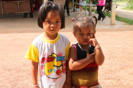 MUANG, MAHASARAKHAM - JUNE 29 : Unidentified girls are acting to camera on June 29, 2012 at Ban Moh (Pottery village), Muang, Mahasarakham, Thailand. Stock Photo - 14339282