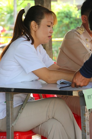 MUANG, MAHASARAKHAM - JUNE 29 : Unidentified officer is checking names list in village level election on June 29, 2012 at Ban Moh (Pottery village), Muang, Mahasarakham, Thailand. Stock Photo - 14335640
