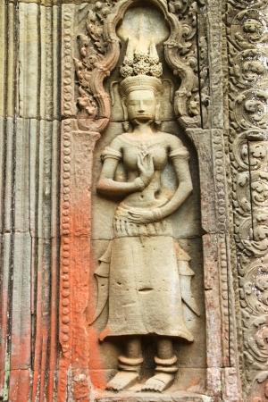 cambodge: Apsara sandstone carving at Ancieht Ta Prohm Prasat, Siamreap, Khmer Republic Stock Photo