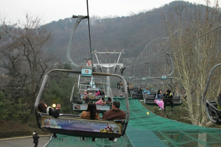 EVERLAND, YONGIN, KOREA - NOVEMBER 26 : Unidentified tourists are sitting on cable cars on November 26, 2011 at Everland, Yongin, Korea.