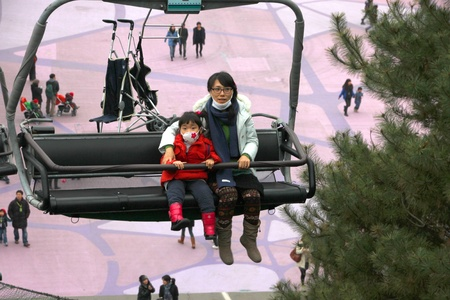 EVERLAND, YONGIN, KOREA - NOVEMBER 26 : Unidentified tourists are sitting on cable car on November 26, 2011 at Everland, Yongin, Korea.