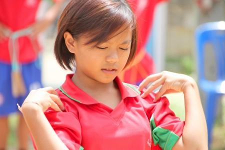 MUANG, MAHASARAKHAM - JUNE 11 : Unidentified school girl is in exercise jumping roap show on June 11, 2012 at Don Tum village plaza, Muang, Mahasarakham, Thailand.