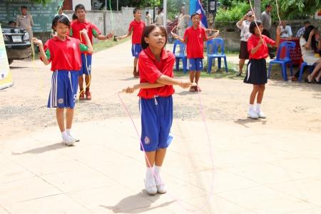 MUANG, MAHASARAKHAM - JUNE 11 : Unidentified school children are in exercise jumping roap show on June 11, 2012 at Don Tum village plaza, Muang, Mahasarakham, Thailand. Editorial