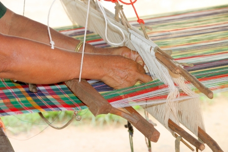 Traditional handmade textile weaving in rural Thai photo