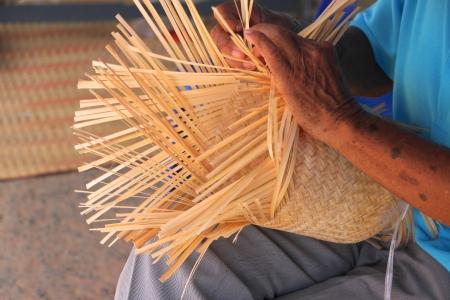 Traditional handmade bamboo weaving in rural Thai photo