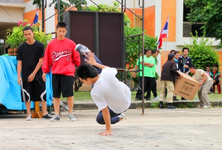 MUANG, MAHASARAKHAM - JUNE 24 : Unidentified boys are performing B-Boy dance in mini - half marathon contest and festival on June 24, 2012 at city plaza, Mahasarakham, Thailand.