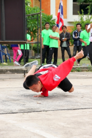 MUANG, MAHASARAKHAM - JUNE 24 : Unidentified boy is performing B-Boy dance in mini - half marathon contest and festival on June 24, 2012 at city plaza, Mahasarakham, Thailand.