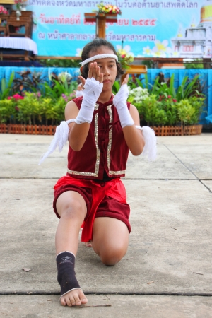 MUANG, MAHASARAKHAM - JUNE 24 : Unidentified girl is performing Boxing dance in mini - half marathon contest and festival on June 24, 2012 at city plaza, Mahasarakham, Thailand.