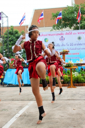 MUANG, MAHASARAKHAM - JUNE 24 : Unidentified girls are performing Boxing dance in mini - half marathon contest and festival on June 24, 2012 at city plaza, Mahasarakham, Thailand.