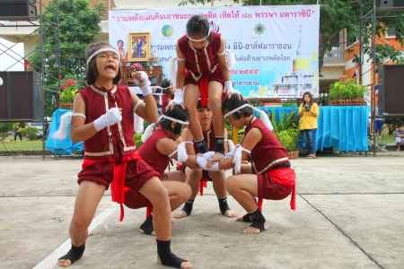 welth: MUANG, MAHASARAKHAM - JUNE 24 : Unidentified girls are performing Boxing dance in mini - half marathon contest and festival on June 24, 2012 at city plaza, Mahasarakham, Thailand. Editorial