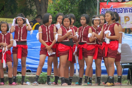 welth: MUANG, MAHASARAKHAM - JUNE 24 : Unidentified girls are waiting for perform Boxing dance show in mini - half marathon contest and festival on June 24, 2012 at city plaza, Mahasarakham, Thailand.