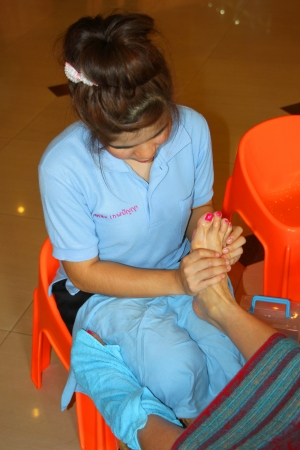 MUANG, MAHASARAKHAM - JULY 13 : Unidentified woman is in reflexology spa foot massage on July 13, 2012 at Taksila Hotel, Muang, Mahasarakham, Thailand. Stock Photo - 14418864