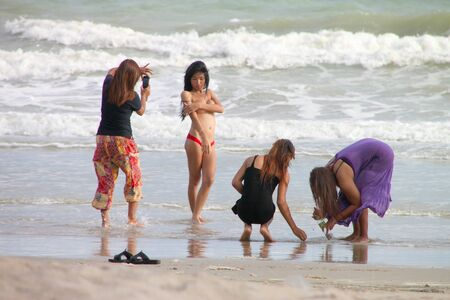 CHANTA BURI, THAILAND - MAY 25 : Unidentified tourists are playing on the beach on May 25, 2012 at Chao Lhao Beach, Chanta Buri, Thailand.