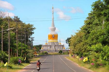 mahasarakham: NA DUN, MAHASARAKHAM - JULY 15 : The unidentified Buddhists are heading to do religious merit as usual on July 15, 2012 at Na Dun Pagoda, Mahasarakham, Thailand. Editorial