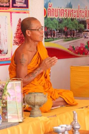 mahasarakham: NA DUN, MAHASARAKHAM - JULY 15 : The unidentified Buddhist monk is praying on July 15, 2012 at Na Dun Pagoda, Mahasarakham, Thailand.