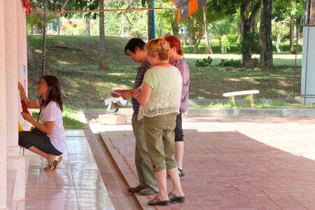 mahasarakham: NA DUN, MAHASARAKHAM - JULY 15 : The unidentified tourists are traveling to make religious merit on July 15, 2012 at Na Dun Pagoda, Mahasarakham, Thailand.