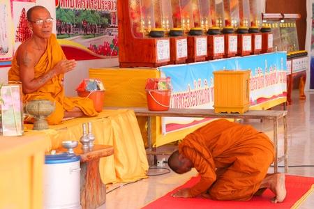 mahasarakham: NA DUN, MAHASARAKHAM - JULY 15 : The unidentified Buddhist monks are in worshiping together on July 15, 2012 at Na Dun Pagoda, Mahasarakham, Thailand.