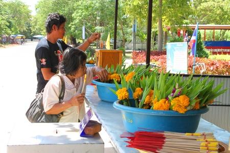mahasarakham: NA DUN, MAHASARAKHAM - JULY 15 : The unidentified Buddhists are making religious merit as usual on July 15, 2012 at Na Dun Pagoda, Mahasarakham, Thailand. Editorial