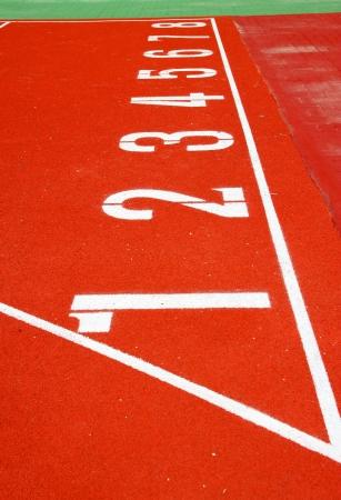 Numbers on running tracks of athletics in central public stadium, Mahasarakham, Thailand