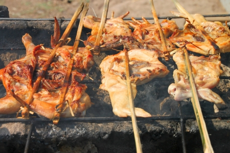 gridiron: Barbecue of grilled chicken on gridiron charcoal stove Stock Photo