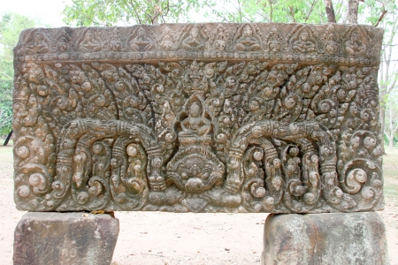 Lintel, Baphuon style, 11 th century of Central tower of Prasat Muang Tam, Buriram, Thailand photo
