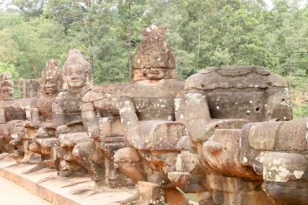 Naga, gods and guardians statue on the bridge at entrance of Angkor Thom, Siamreap, Khmer Republic photo