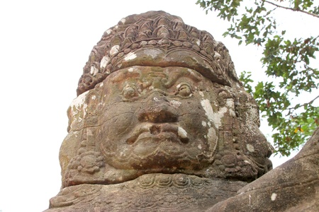 Guardian statue on the bridge at entrance of Angkor Thom, Siamreap, Khmer Republic photo