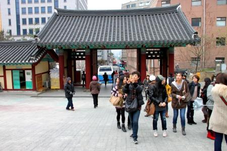 NAMSANGOL HANOK VILLAGE, CENTRAL SEOUL, KOREA - NOVEMBER 27 : The unidentified tourists are  visiting Korean cultural village on November 27, 2011 at Central Seoul, Korea.