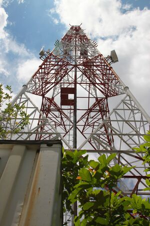 Telecommunication tower and antenna against the sky photo