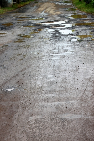 Broken, damaged and cracked road in local motorway photo