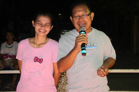 RAYONG, THAILAND - MAY 25 - Unidentified duo singers are singing a song, dancing and performing in ocean coast party on May 25, 2012 at local beach, Rayong, Thailand.