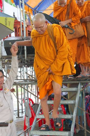 headman: MUANG, MAHASARAKHAM - AUGUST 10 : Unidentified monks are going back temple after making religious ceremony of Village Headman establishment Day on August 10, 2012 at City plaza, Muang, Mahasarakham, Thailand
