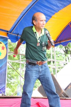 headman: MUANG, MAHASARAKHAM - AUGUST 10 : Unidentified man is performing in ceremony of Village Headman establishment Day on August 10, 2012 at City plaza, Muang, Mahasarakham, Thailand