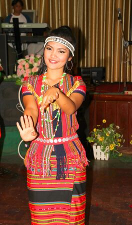 VIENTIANE, LAO P.D.R. - MAY 21 : Unidentified woman is performing Lao dance on May 21, 2012 at KM 4 Riverside Restaurant - Karaoke, Vientiane, Lao P.D.R.
