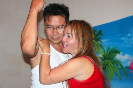 BORABUE, MAHASARAKHAM - JUNE 1 : Unidentified woman and man are enjoy singing a song on June 1, 2012 at 99 Karaoke, Borabue, Mahasarakham, Thailand.