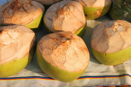 Fresh and young coconuts in tropical fruits market Stock Photo - 15214502