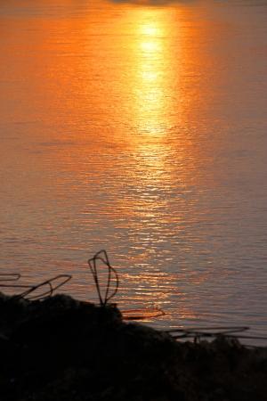 khong river: Sunset at Khong River, view from Thailand