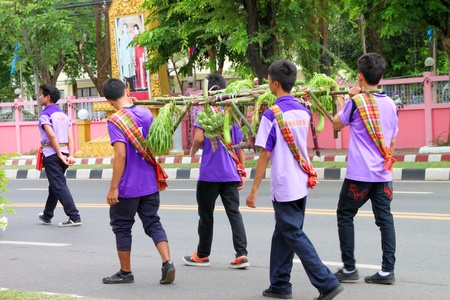 MUANG, MAHASARAKHAM - AUGUST 25 : Unidentified school paraders are marching in sport day, promote good activities and protest in bad social issues on August 25, 2012 at city plaza, Muang, Mahasarakham, Thailand.