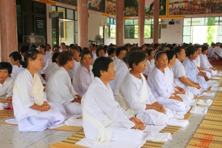 usual: MUANG, MAHASARAKHAM - AUGUST 25 : Unidentified Buddhists are making religious merit as usual in Buddhist holy day on August 25, 2012 at Wat Sratong Teparam, Muang, Mahasarakham, Thailand.